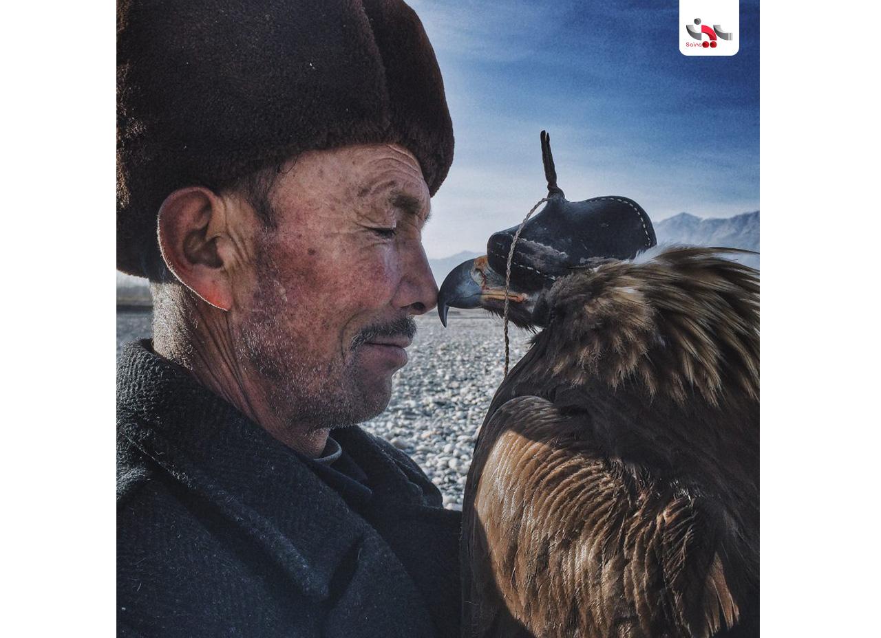 برنده جایزه بزرگ: Siyuan Niu با عکس مرد و عقاب